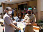 Pemkab Lutim Melalui Dinas PMD Serahkan Bantuan Kendaraan Operasional untuk Kadus